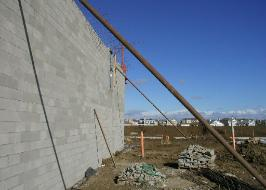 Concrete Masonry Unit Construction, Wall Failure Caused by Wind
