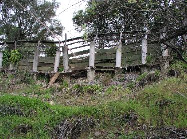 Failure of Earth Retaining Wall - Concrete Piers & Wood Lagging